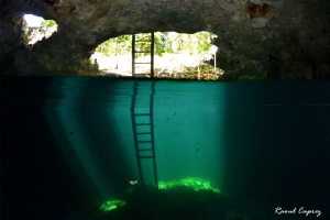 Light show in the Calavera cenote by Raoul Caprez 
